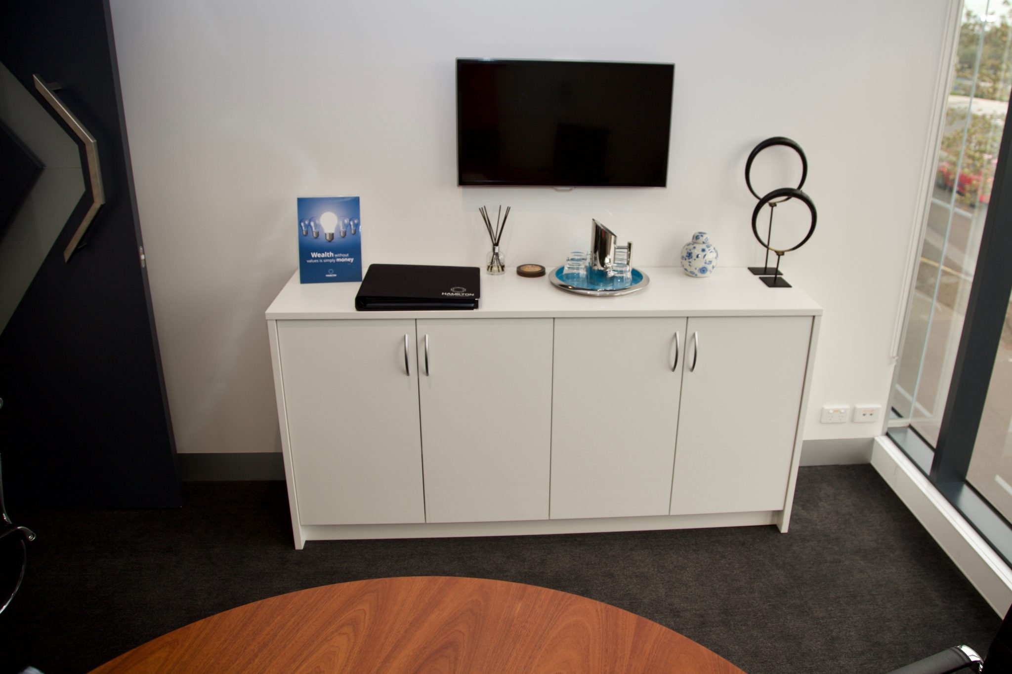 white storage credenza in an office meeting room