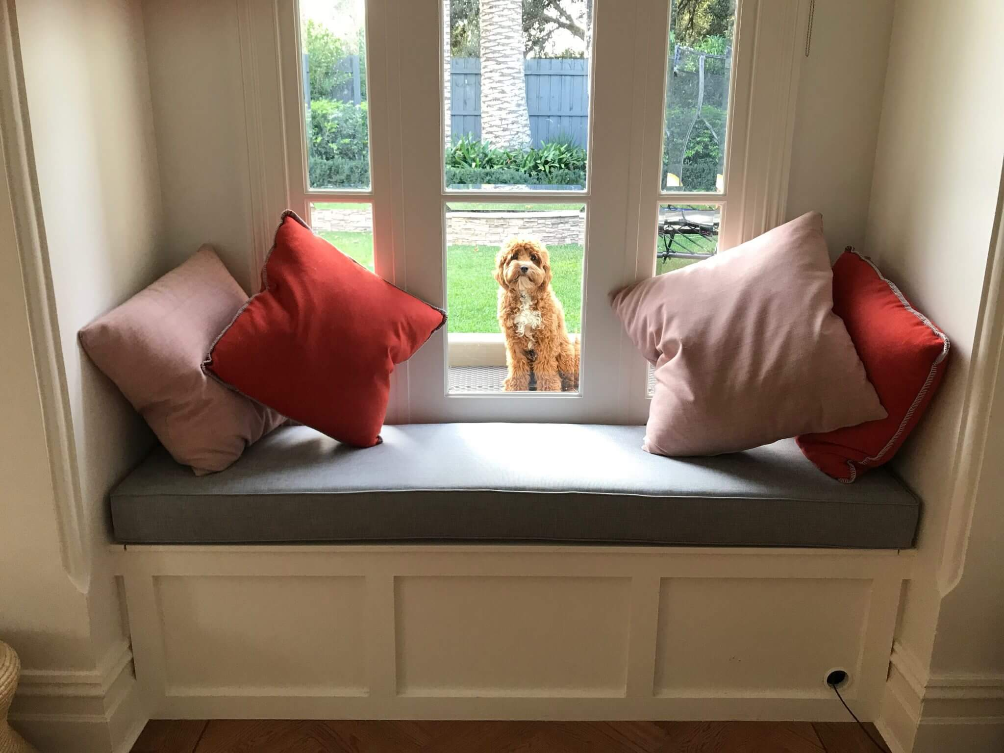 upholstered window seat with cushions