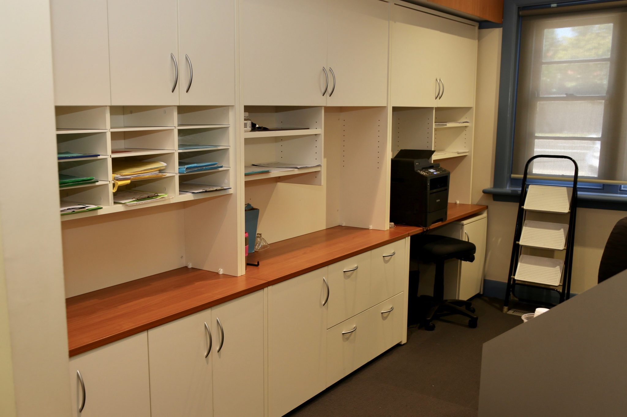 Medical rooms filing area with overhead cabinets