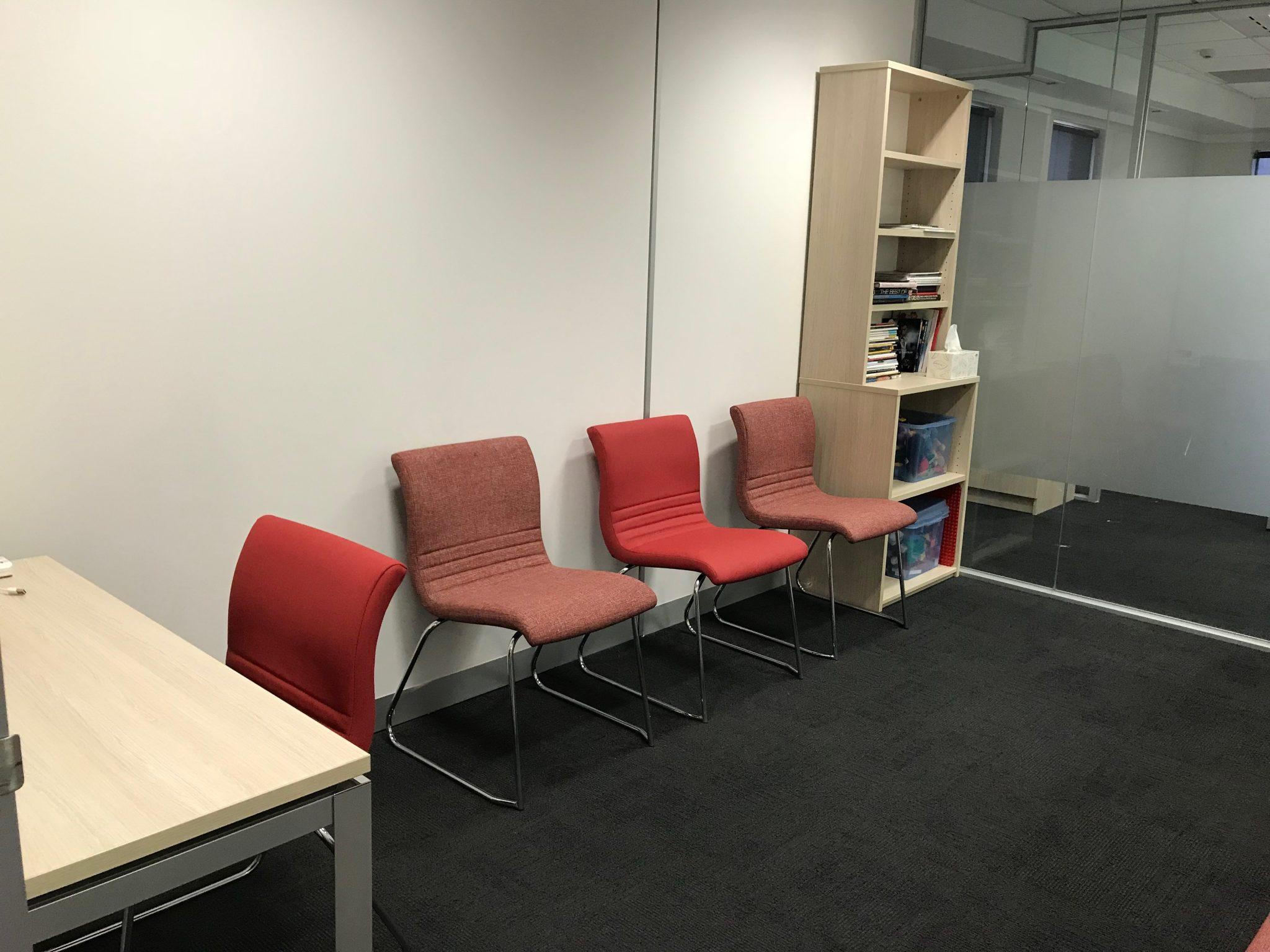 medical waiting room with waiting room chairs in red upholstery