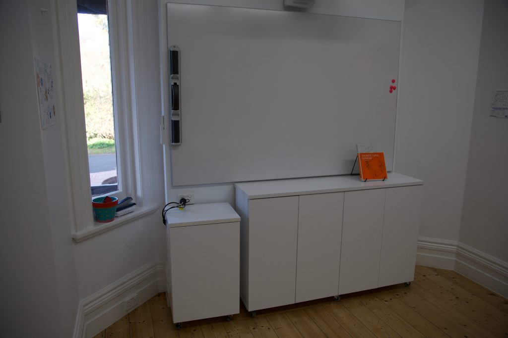 white AV storage unit in a school room