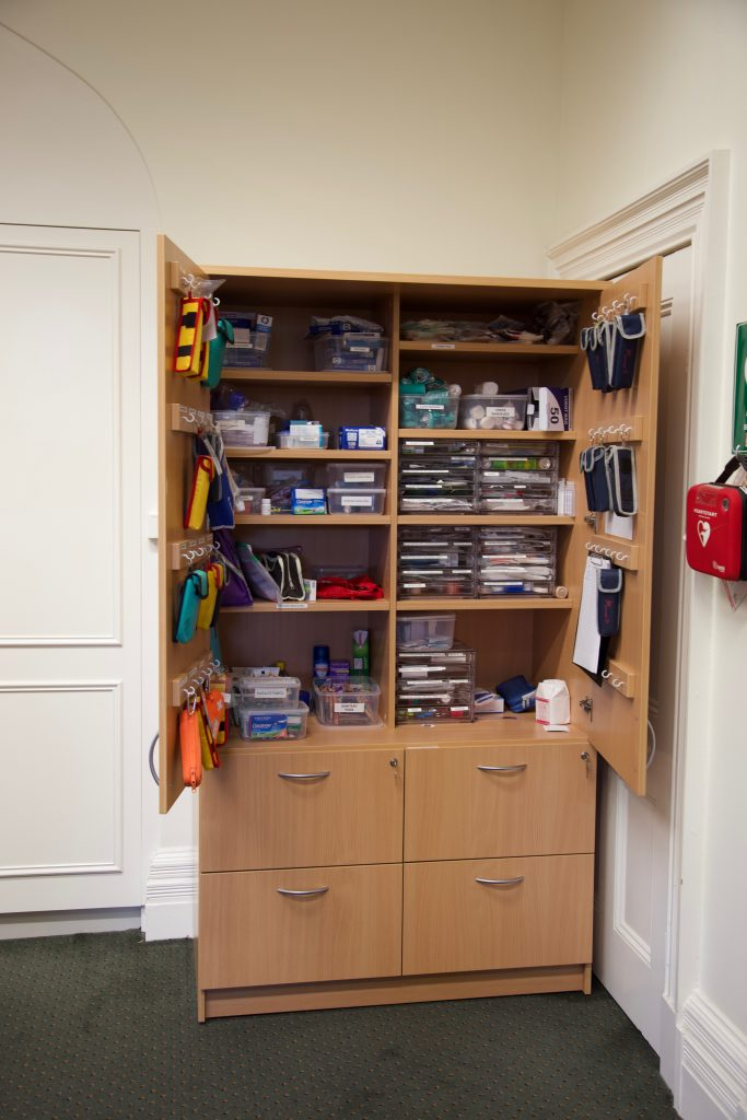 school storage cupboard with medical supplies